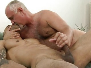 sexy tattooed homosexual giving handjob to his